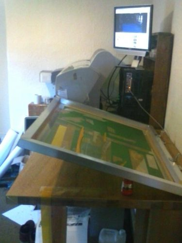 Basic poster screen printing setup with clamps