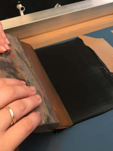 Charge the screen with ink - Pull ink over design with no pressure applied